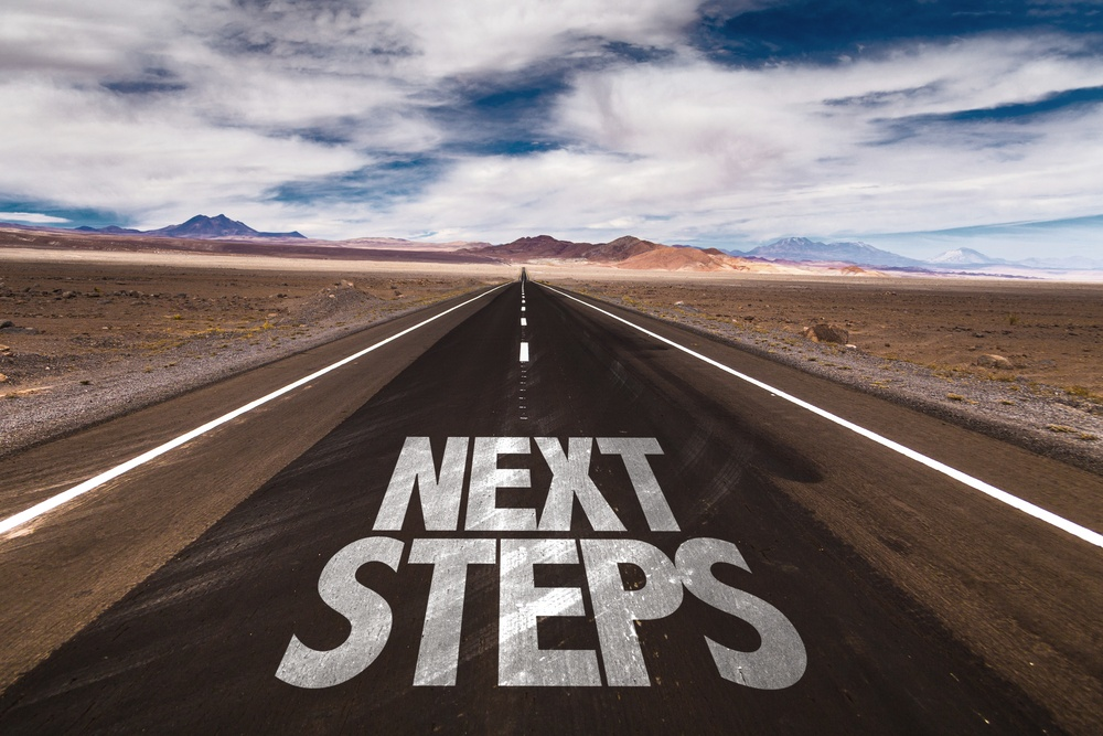 Next Steps written on desert road